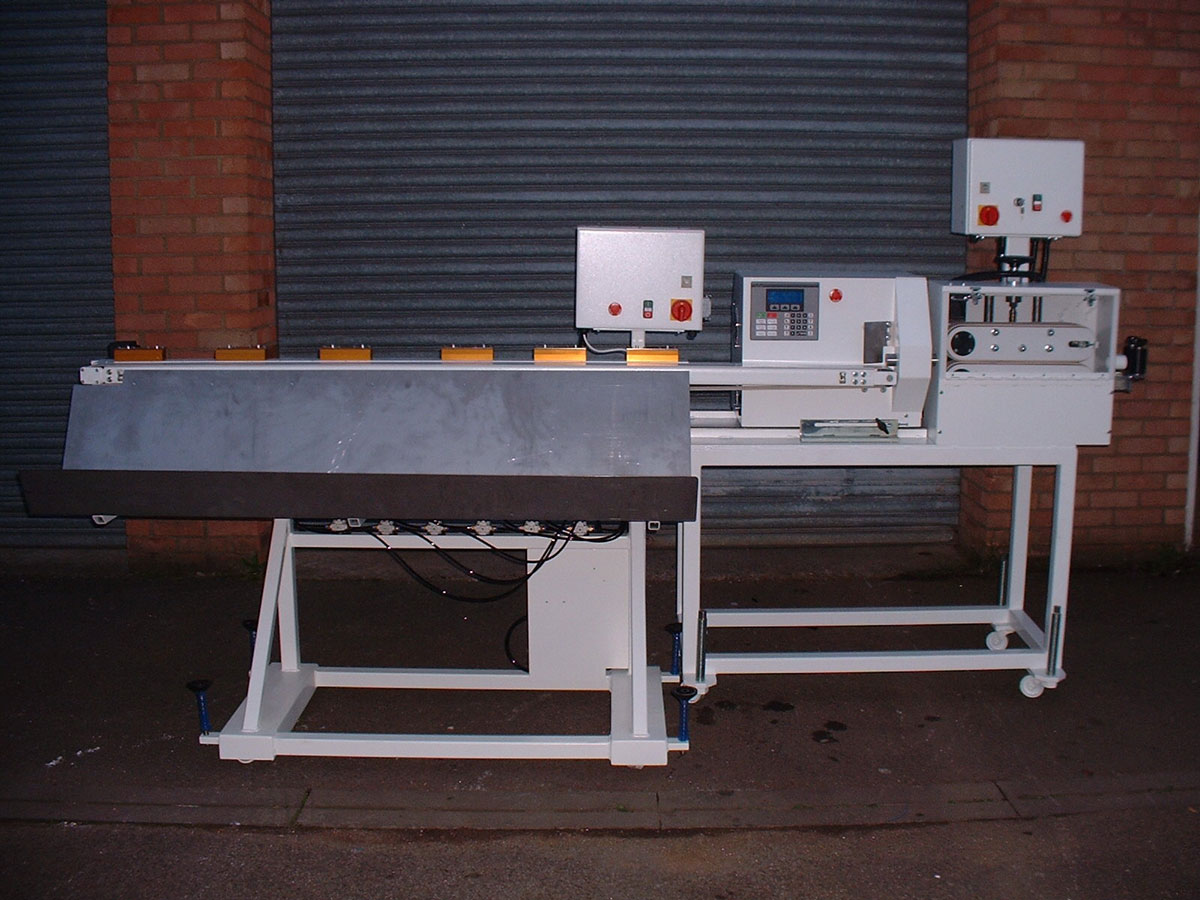 services - combined haul off servo cutter with conveyor blow off table